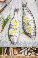 Preparing sea breams with thyme and salt for grill