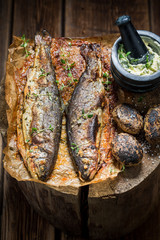 Trout fish served with potatoes, herbs and butter