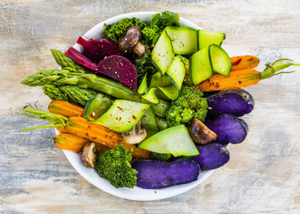 Delicious and healthy salad with colorful vegetables. Rainbow food.