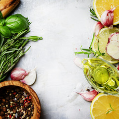 Food background, spices, herbs, olive oil and seasonings, top view