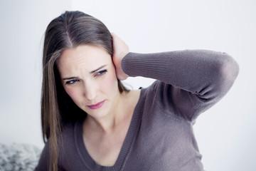 Woman suffering from earache