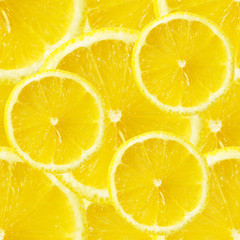 Seamless background of lemons slices
