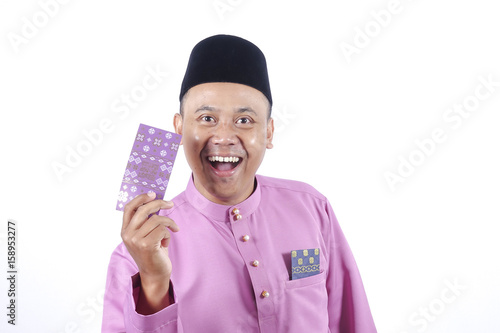man in traditional clothing cheerful with money packet during
