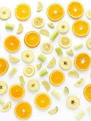 Orange slices and apples on a white background. Fruit pattern. Abstract food background. Top view.