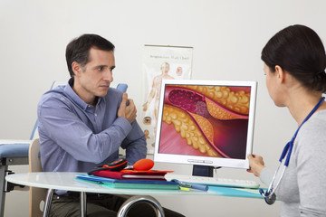 Models On screen, drawing representing an artery obstructed by a thrombus caused by a plaque of atheroma