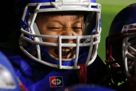 A player of the Sharklets reacts as he plays the Eagles during their Future League American football youth league match in Beijing