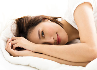 young beautiful woman sleeping in the bed.