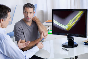 Male patient consulting for elbow pain