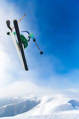 Wall Mural - good skiing in the snowy mountains, Carpathians, Ukraine, good winter day, incredible ski jump, ski season