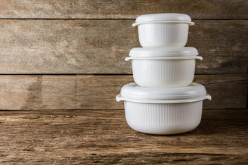 Empty containers for food on wooden background
