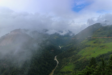 Scenery of foggy hills and Mangde River in Bumthang, Bhutan