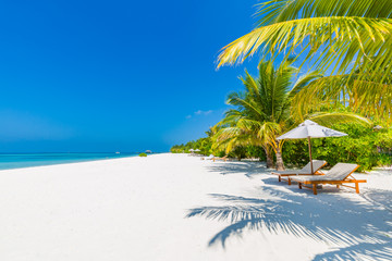 Vacation holidays background wallpaper two beach lounge chairs under tent on beach. Beach chairs & Search photos