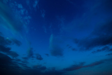 Starry sky with clouds. Summer twilight.