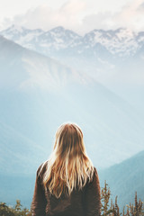 Blonde Woman enjoying mountains landscape Travel Lifestyle wanderlust concept adventure summer vacations outdoor girl traveler in harmony with nature