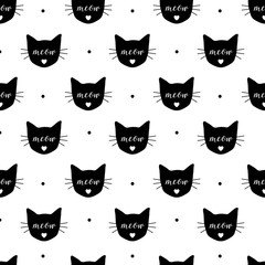 Seamless pattern with black cats. Vector, eps10. Fabric print.Repeating wallpaper. Textile design. Meow and cat head. Cute background.