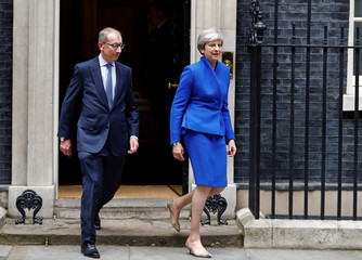 Britain's Primer Minister Theresa May leaves Downing Street with her husband on the way to Buckingham Palace after Britain's election in London