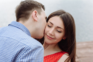 kiss. beautiful girl embraces the guy