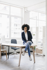 young businesswoman sitting in her office