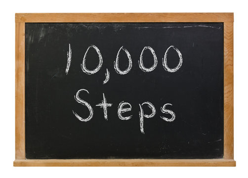 10,000 Steps written in white chalk on a black chalkboard isolated on white
