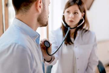 Close up of women doctor examining patient.