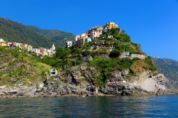 Vernazza, Italy colorful houses perched on a rocky hill above Mediterranean Sea on Cinque Terre coast