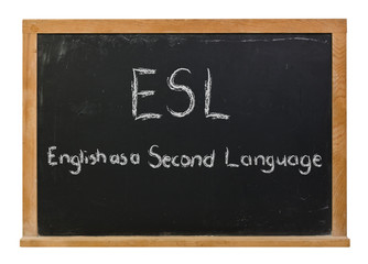 ESL English as a second language written in white chalk on a black chalkboard isolated on white