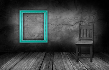 Cyan frame and wood chair in interior room with gray stone wall