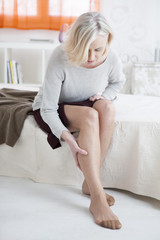 Senior woman suffering from leg pain