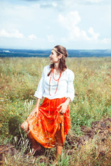 Woman in a skirt in the field