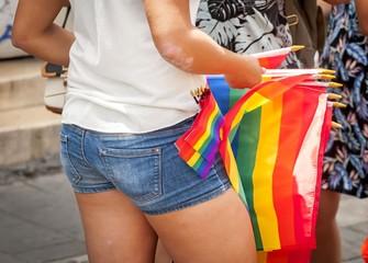 TEL AVIV, ISRAEL. June 9, 2017. Girl selling LGBT rainbow flags in the street due to the Gay Pride Parade in Tel Aviv 2017.