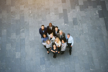 Multiethnic office workers team looking up in hall