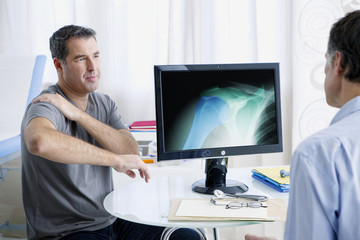 Male patient consulting for shoulder pain