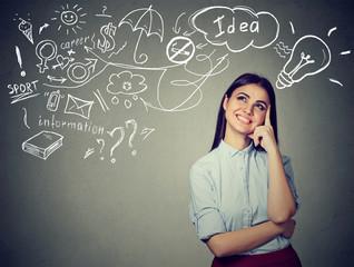 woman thinking dreaming has many ideas looking up at plan