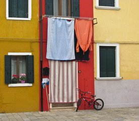 Burano, near Venice, Italy. Bright colored houses and laundry hung up to dry
