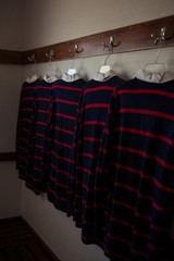 Rugby shirts hanging in room