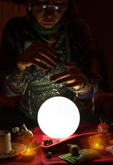 Gypsy fortune teller woman and crystal ball