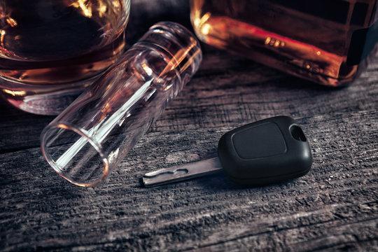 Car keys and fallen empty glass