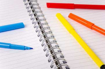 Felt Tip Pens on a Open Notebook