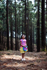 Little girl alone in the forest