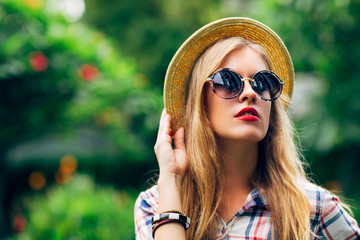 Portrait of a Beautiful Blonde Woman With Sunglasses