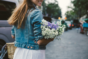 Girl holding a bouquet of wildflowers