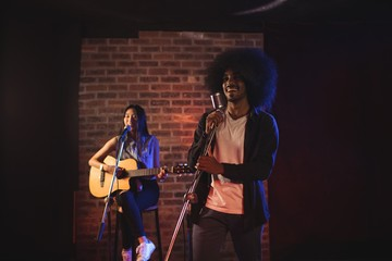 Male and female singers performing in nightclub
