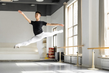 Young professional male dancer practicing in a studio