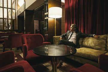 Businessman Sitting in a Hotel Lobby