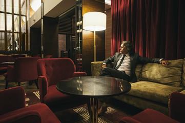 Businessman Sitting in a Hotel Lobby