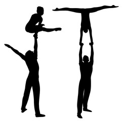 Gymnasts acrobats vector black silhouette on black background. Gymnasts acrobats vector