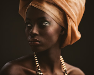 African Woman With an Orange Turban