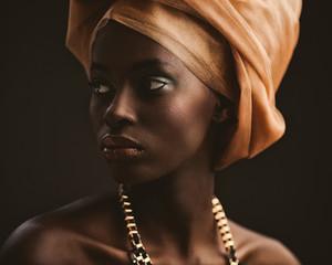 African Woman With an Orange Turban