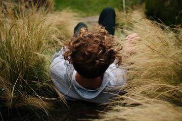 Male model sitting in long grass