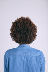 Back view of African American woman with brown curly hair